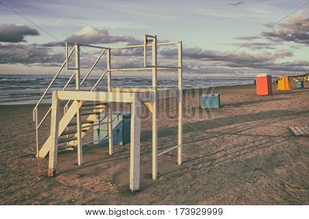 The tower and the colored boxes on the sandy Baltic sea beach in Jurmala