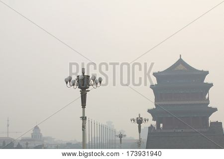 Tiananmen tower enveloped by the heavy fog and haze. Air pollution and poor air quality as the development of industry.