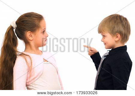 Funny little boy teaches the girl. isolated on white