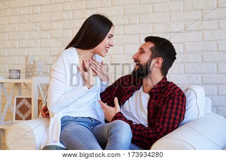 Close-up of wife and husband who is talking and discussing news together in the living room isolated over white background