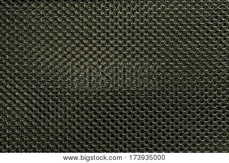 Yellow fishnet cloth material as a texture background. Nylon texture pattern or nylon background for design with copy space for text or image.