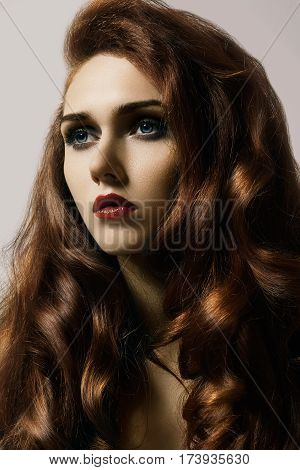 Beautiful Ginger Young Woman With Luxury Hair Style And Fashion Gloss Makeup. Beauty Closeup Sexy Mo