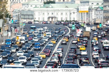 Lanes of a wide city street with lots of cars
