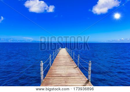 Wooden Bridge Juts Out Into  Of The Sea