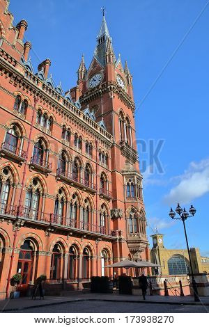 LONDON, UK - FEBRUARY 28, 2017: Exterior view of St Pancras Railway Station with the renovated facade of  Kings cross railway station in the background. This building  now houses the luxury St Pancras Renaissance Hotel