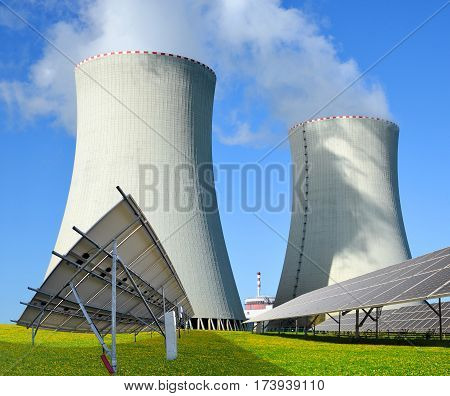 Solar panels and nuclear power plant. Energy resources concept.
