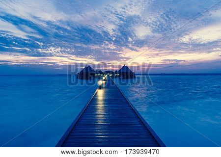 Fantastic sunset on a tropical island in the Maldives. Luxury Resort Angaga. Ari Atoll.