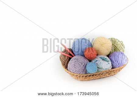 Colored yarn on a white background. Skeins of wool yarn for knitting. Balls of wool of different colours for handmade knitting on a wooden background with copy space for ad