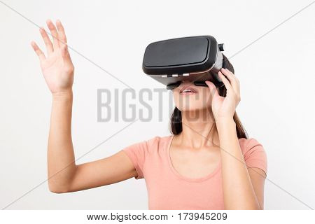 Woman looking though the VR device and hand up