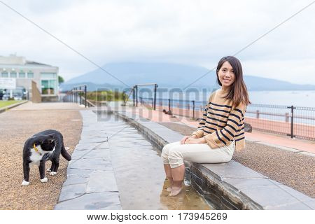 Woman with kitten and enjoy foot bath