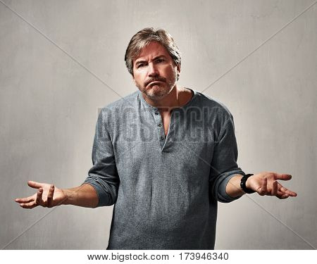 frustrated depressed man portrait over gray sepia background
