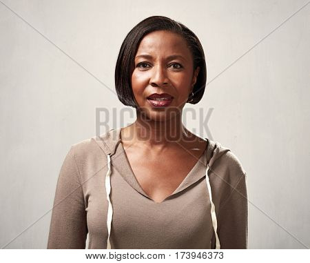 African american attractive woman portrait over gray sepia background