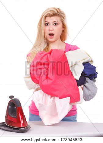 Woman Having A Lot Of Clothes To Iron