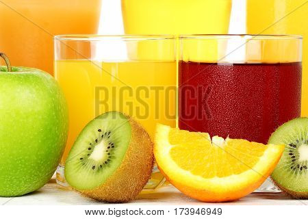 glasses with a variety of juice and fruit