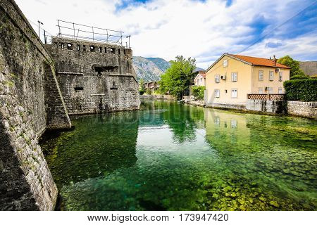 Mediterranean landscape. Medieval city walls, fortifications and river in Kotor, Montenegro.