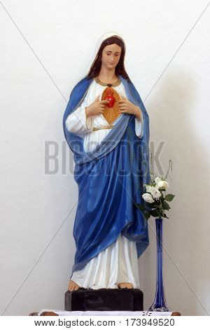 HRVATSKA DUBICA, CROATIA - NOVEMBER 18: Immaculate Heart of Mary statue on the altar in Parish Church of Holy Trinity in Hrvatska Dubica, Croatia on November 18, 2010.