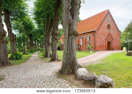 Haseldorf Germany-June 24 2011:Church of St. Gabriel. Church of the thirteenth century built of red brick and the alley in the old Park