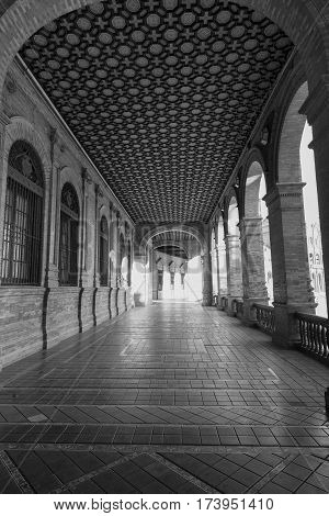 Sevilla (Andalucia Spain): the square known as Plaza de Espana. Portico. Black and white