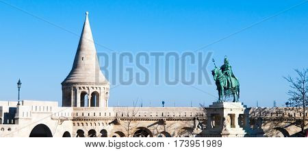 Mounted statue of Saint Stephen I, aka Szent Istvan kiraly - the first king of Hungary at typical white rounded tower of Fisherman's Bastion in Buda Castle in Budapest, Hungary, Europe. Sunny day shot with blue sky on the background.
