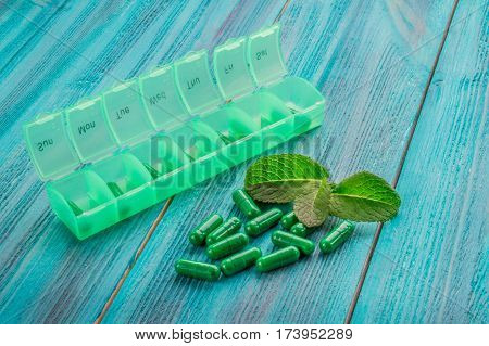 Nutritional Supplements In Capsules On A Wooden Background