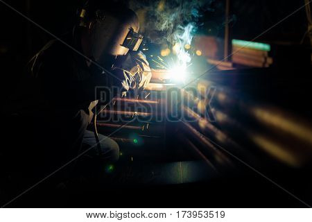Welding at the industrial factory for steel production heavy industrial at night