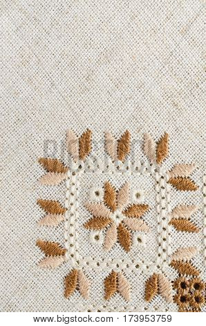 Ukrainian embroidered folk pattern ornament. Ethnic texture design. Geometric ornament. Embroidered element on flax by cotton threads. Needlework.