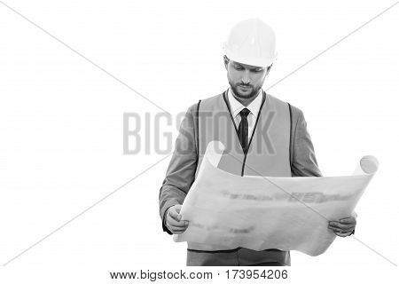 Your dedicated worker. Monochrome studio shot of a businessman contractor examining building plan on a blueprint looking serious copyspace against white background professionalism building engineering