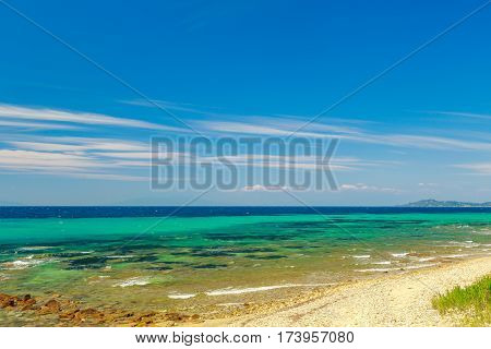 The Rocky Coast   Overlooking The Turquoise Blue And Green Sea  In A Warm Summer Day.