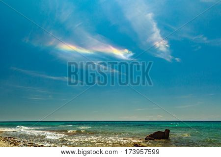 The Rainbow  At The Rocky Coast  Overlooking The Turquoise Blue Sea In Warm Summer Day.