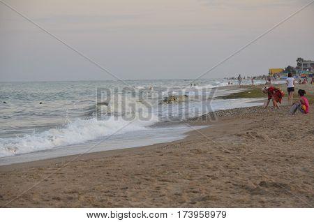 Odessa Ukraine - July 29 2014: Unidentified people relaxing on the sandy beach of the Black Sea in Odessa Ukraine