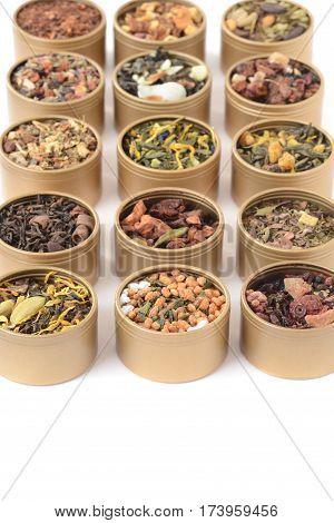 closeup rows of organic herbal tea in tins