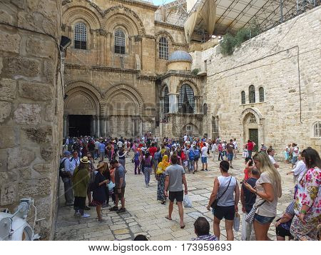 JERUSALEM ISRAEL - June 21 2015: Groups of tourists at the entrance to the Church of the Holy Sepulchre in the Old city of Jerusalem Israel