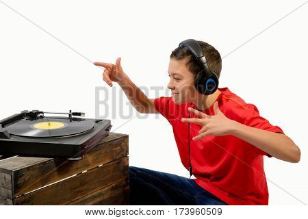Teenage boy listening to a LP with headphones