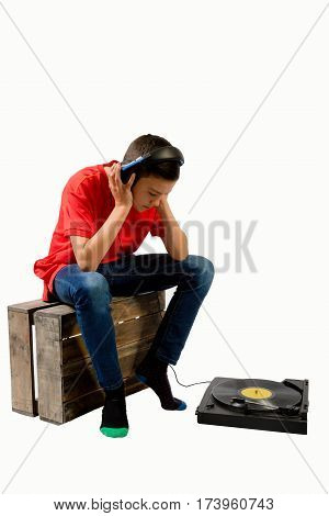 Teenage boy listening to a LP with his eyes closed