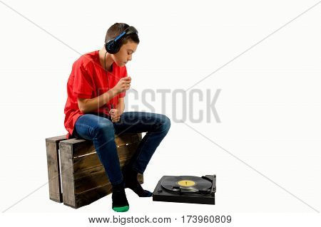 Teenage boy air drumming to music on a LP