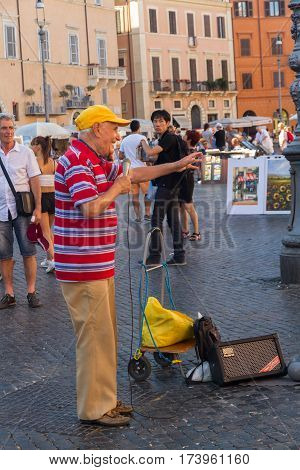 ROME - AUGUST 28: Street singer or busker in Piazza Navone on August 28 2016 in Rome