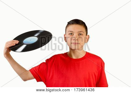 Teenage boy holding a LP in his hand