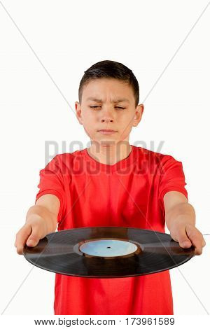 Teenage boy holding a LP in front on him