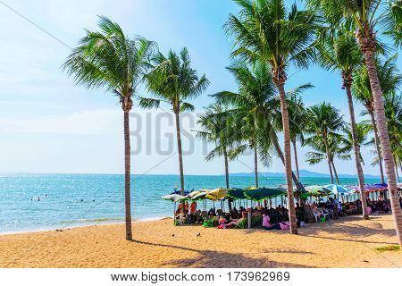 PATTAYA THAILAND - JANUARY 24: This is a view of Jomtien beach a popular tourist beach in Pattaya where many travellers come to sunbath on January 24 2017 in Pattaya