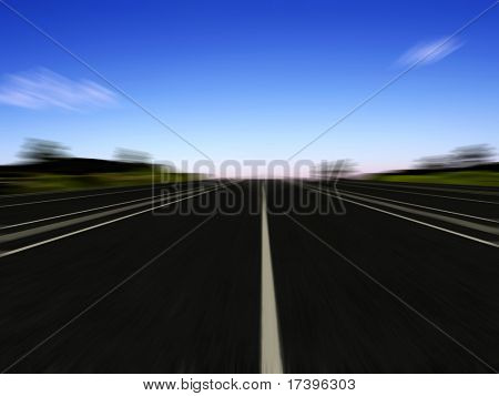 The road on the background of a colorful sunset