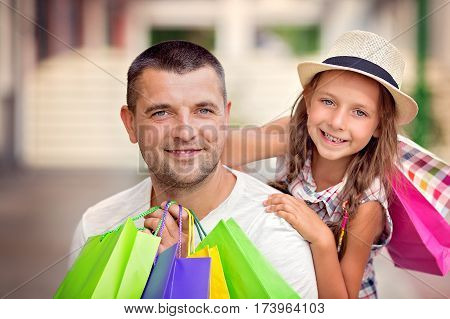 Happy father with daughter have a successful day of shopping