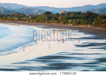 Tropical sandy beach in the town of Jaco, Costa Rica