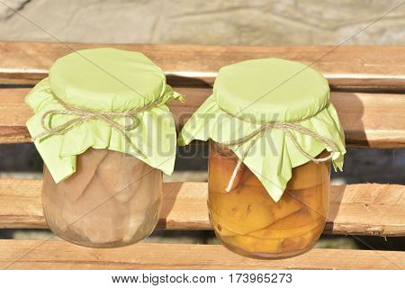 Jars with fruity compotes . Preserved fruits.