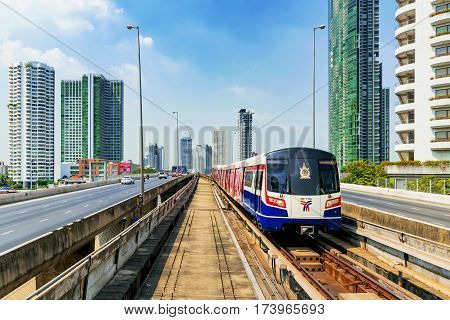 BANGKOK THAILAND - JANUARY 30: BTS Sky train arriving at Saphan Taksin station on Taksin bridge with city architecture in the background on January 30 2017 in Bangkok