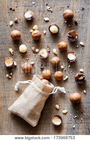 Shelled And Unshelled Macadamia Nuts On Wooden Board