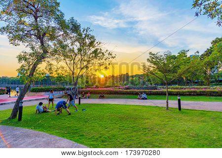 BANGKOK THAILAND - FEBRUARY 01: People stretching and warming up for jogging in Benjakitti park a popular place for joggers in Bangkok on February 01 2017 in Bangkok