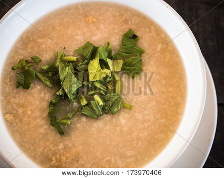 rice gruel in bowl on table wood