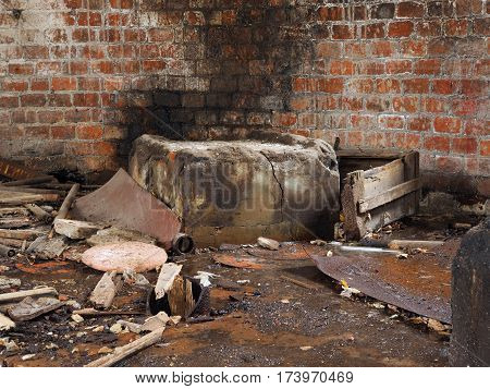 lot of debris dirt. Brick wall of an old abandoned tower