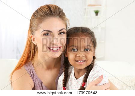 Happy mother and African American daughter