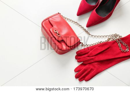 Dry cleaning business concept. Stylish women accessory set on light background